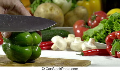 Cutting Knife Green Bell Pepper - Hands cook cut into large...