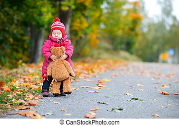 Baby girl outdoors - Adorable baby girl walking outdoors...