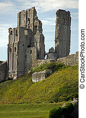 Castle fort ancient ruins on a hill top with blue sky and...