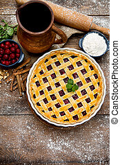 Homemade cherry pie on wooden table Elevated view