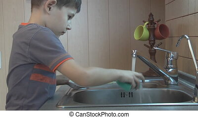 wash the dishes - boy washing dishes