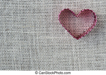 Red Heart on Burlap Background