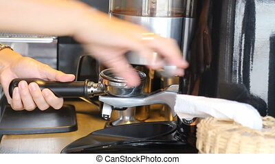 Barista Making Ground Coffee With Coffee Grinder, Stock...