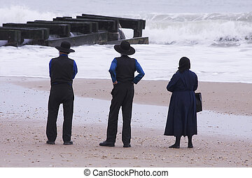 Amish at Ocean - Three amish people enjoying the ocean
