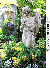 Praying angel  - Statue of a praying angel in the garden.