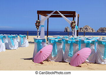 Beach wedding ceremony set up in Cabo San Lucas. Also...