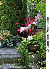 Cottage garden chair - Colorful rocking chair in a cottage...