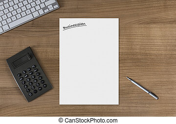 Blank sheet Businessplan on a wooden table with calculator -...
