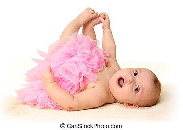 Baby girl wearing a pink tutu