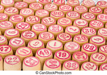 Wooden counters for bingo with red numbers - Wooden counters...