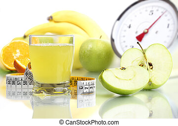 Apple juice in glass, fruit meter scales diet food