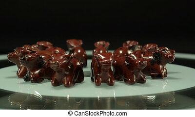 Rotating obsidian mahogany oxen - Hand carved mahogany...