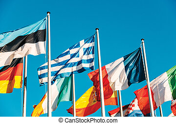 Greece flag waving in front of European Parliament, next to...