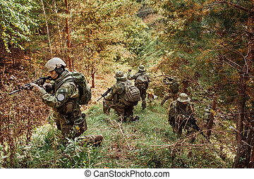 a group of military intelligence in the woods leads