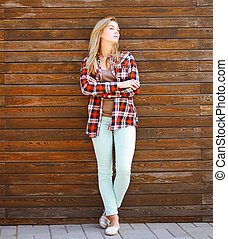 Modern pretty hipster girl in smart casual clothes posing...