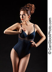 The girl in a bathing suit with curly hair. - The girl in a...