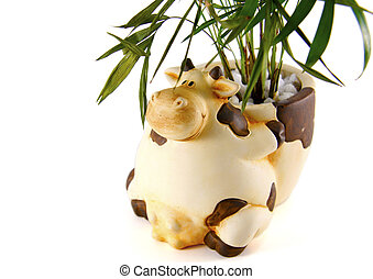 Decorative clay cow plant pot on white