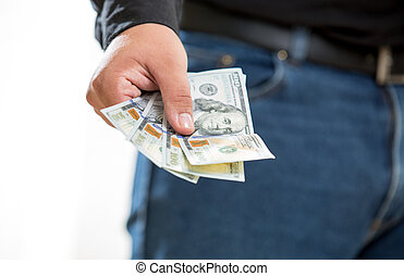 man showing hand with hundred dollar banknotes