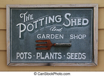 Old potting shed sign - Old weathered sign of a potting...