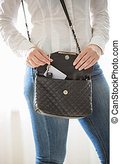 portrait of woman taking keys out of purse - Closeup...