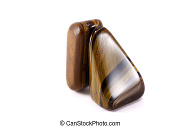 Tigers eye gem stones isolated on white