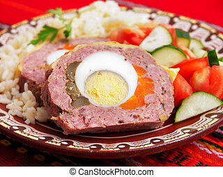 Meatloaf with eggs, carrots and cucumbers