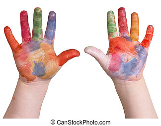 hands in paint - child is holding up painted art hands on a...