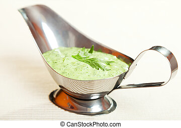 Salad dressing with mayonnaise and fresh green herbs