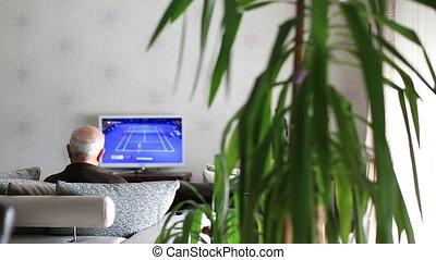 Senior Man Watching Television at home