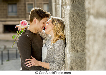 beautiful couple in love kissing on street alley celebrating...