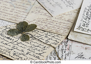 Four leave clover  - Clover leave on old letters