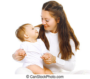 Happy mother playing having fun baby on a white background