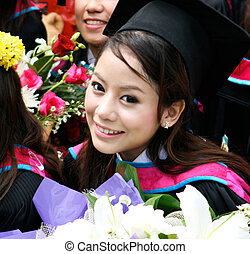 University graduate - Portrait of a beautiful Asian...