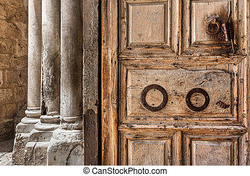 Wooden door at the entrance to Hole Sepulchre church. -...