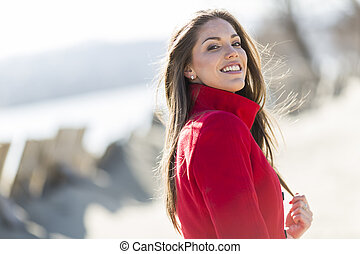 Pretty young woman in red coat