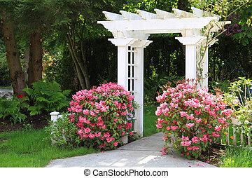 Garden arbor and pink flowers. - Pretty garden arbor with...