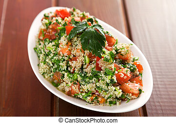 Quinoa tabouleh in a bowl served on the table