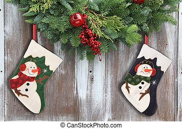 Christmas garland and stockings. - Christmas garland with a...