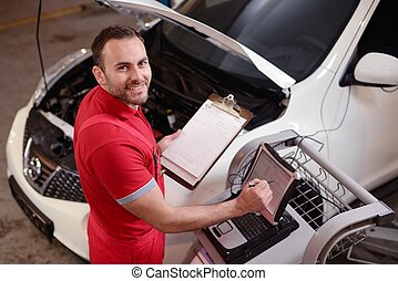 Car Mechanic - Man working in a garage