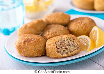 Fish Cakes - A plate of delicious fish cakes.
