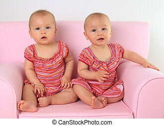 Twin baby girls. - Identical twin baby girls, 10 months old....