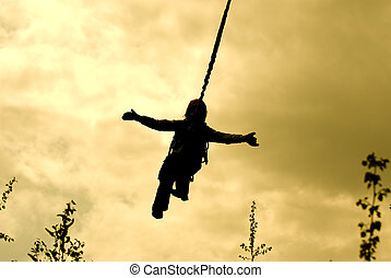 Ropejumper silhouette - Silhouette of a ropejumper flying...