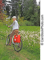 Senior lady cyclist - Senior lady on a bicycle with her...