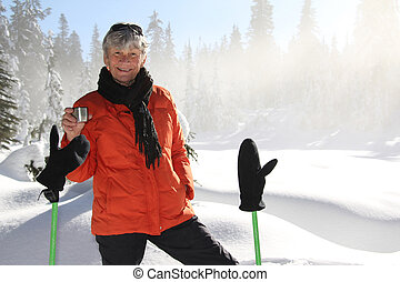 Snowshoeing retirement - Seventy year old lady having fun...