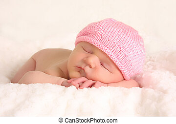Baby girl - Newborn baby girl in a knitted pink hat.
