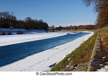 Quay of Uzh river in Uzhgorod during winter time,...