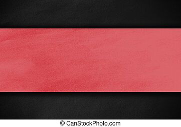 red paper on dark wall