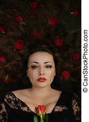 Woman with rose crying blood - Beautiful brunette woman...