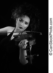 Woman playing old violin Black and white