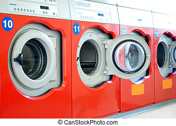 washing machines in a laundromat in a row